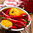 Chili peppers and habanero in colander — Stock Photo