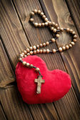 Furry heart with rosary beads — Stock Photo