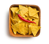 Tortilla chips with red chili pepper in wooden background — Photo