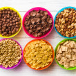 Various kids cereals in colorful bowls — Stok Fotoğraf #32807141