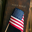 Holy bible with american flag — Stock Photo