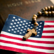 Holy bible with american flag and crucifix — 图库照片