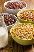 Various sweet cereals in bowls — Stock Photo