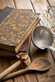 Kitchen tools with cookbook — Stock Photo