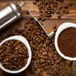 Stock Photo: Coffee beans with ground coffee and grinder