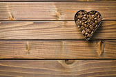 Coffee beans in heart form — Stock Photo