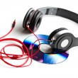 Black headphones with cd — Stock Photo