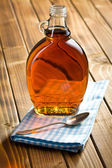Maple syrup in glass bottle — Stock Photo