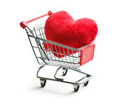 Furry heart in shopping cart — Stock Photo