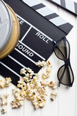 Clapperboard with 3d glasses and popcorn — Stock Photo