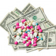 Pills on american dollars — Stock Photo