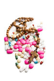 Colorful pills with rosary beads — Foto Stock