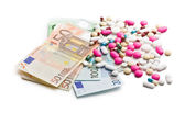 Colorful pills with euro bills — Stock Photo
