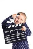 Liten flicka med filmklappa — Stockfoto