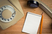 Old telephone with notebook — Stock Photo