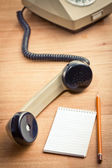 Old telepnone handset with notebook — Foto de Stock