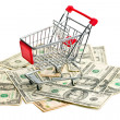 Stock Photo: Shopping cart on americdollars