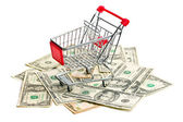 Shopping cart on american dollars — Stock Photo