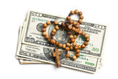 Rosary with american dollars — Stock Photo