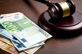 Judge gavel with euro bills — Stok fotoğraf