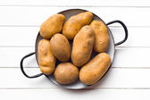 Uncooked potatoes in pot — Stock Photo