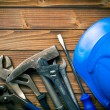 Stock Photo: Hard hat with various working tools