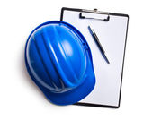 Hard hat with clipboard — Stockfoto