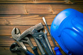Hard hat with various working tools — Stockfoto