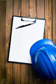 Hard hat with clipboard — Stock Photo