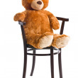 Teddy bear sitting on chair — Stock Photo #41492469