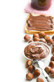 Border with chocolate spread in bowl — Stock Photo
