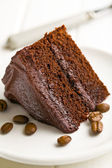 Dark chocolate cake with coffee beans — Stock Photo