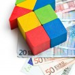House made from wooden toy blocks with euro money — Stock Photo #44121783