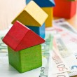 House made from wooden toy blocks with euro money — Stock Photo #44252239
