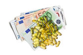 Cod liver oil. Gel capsules with euro currency — Photo