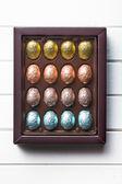 Chocolate eggs in box — Stock Photo