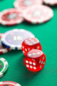 the red casino dice and casino chips — Stockfoto