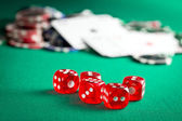 the red casino dice and casino chips — Стоковое фото