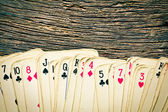Old cards on wooden table — Stock Photo