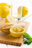 Squeezed lemon fruit and citrus reamer — Stock Photo