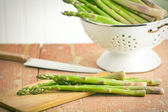 Green asparagus in colander — Stock Photo