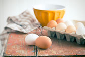Chicken eggs on table — Stock Photo