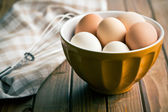 Chicken eggs in bowl — Stock Photo