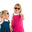 Two little girls showing thumbs up — Stock Photo #48656027