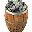 A lot of dollars in a wooden barrel. — Stock Photo