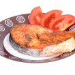 Salmon steak with vegetables on plate — Stock Photo #22330645