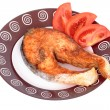 Salmon steak with vegetables on plate — Stock Photo