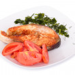 Salmon steak with vegetables on plate. — Stock Photo