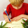Writing christmas wishes — Stock Photo #7669716