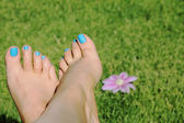 Woman foot with blue nails — Stock Photo